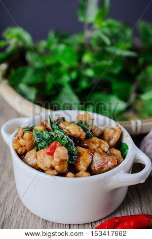 Kapro Kai, Stir Fried Basil Cicken on wooden Thai Famous Food Thai Street Food Thai Cuisine Thai Spicy Food