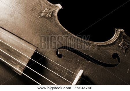 Part of vintage violin on black background