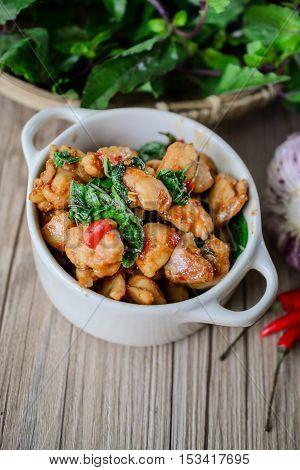 Kapro Kai, Stir Fried Basil Cicken on wooden Thai Famous Food Thai Street Food Thai Cuisine Thai Spicy Food