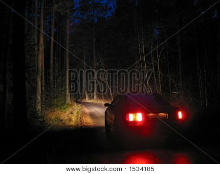 Car On The Road In Deep Forest At The Night.