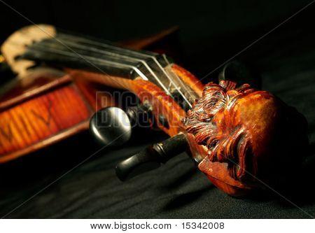 Part of vintage violin on black background