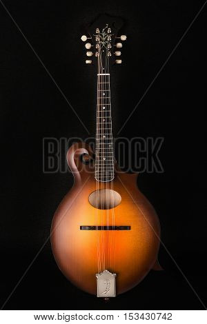 Mandolin on black background front view, mandoline