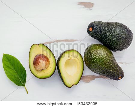Healthy Food Concept . Close Up Fresh Avocado And Leaves On White Shabby Wooden Background. Food Bac