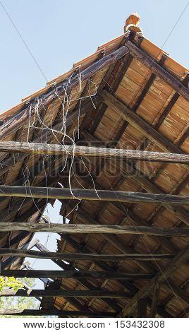 Demolished wooden building that needs roof repairment.