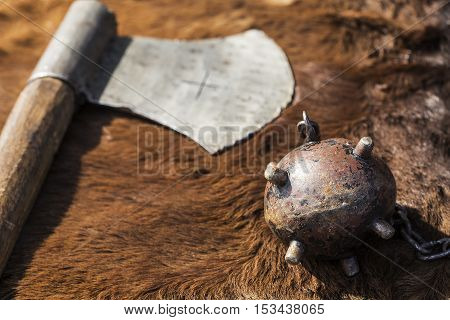 Metal axe and a mace on a cow hide.