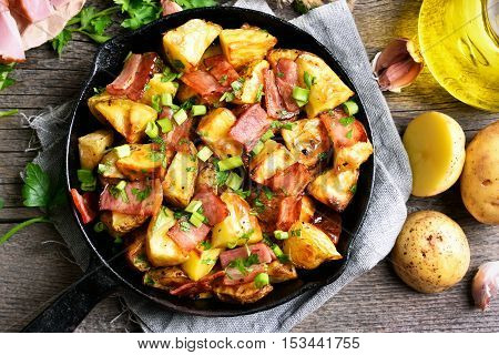Fried potato in frying pan top view close up