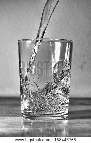 Pour water into a glass Blackandwhite photo
