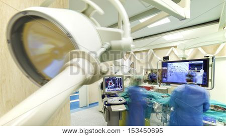 Laparoscopic heart surgery in a modern hospital with specialized equipment - scanners and monitors.