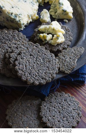 Charcoal biscuits first made in England in the early 1800s to aid digestion prevent gastric ailments. Modern versions go well with cheese