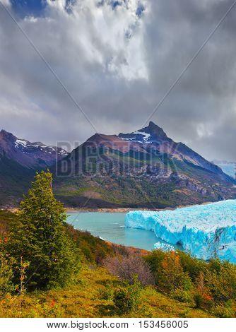 Sunny summer day in February. Los Glaciares National Park in Patagonia. Colossal Perito Moreno glacier in Lake Argentino