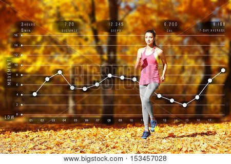 Young woman jogging at park. Graphic of training results. Health care and sport concept.