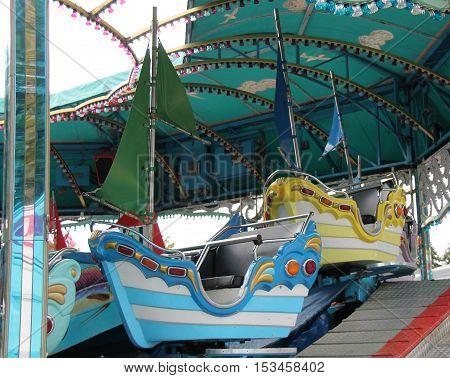 The Seats of a Childrens Fun Fair Sail Boat Ride.