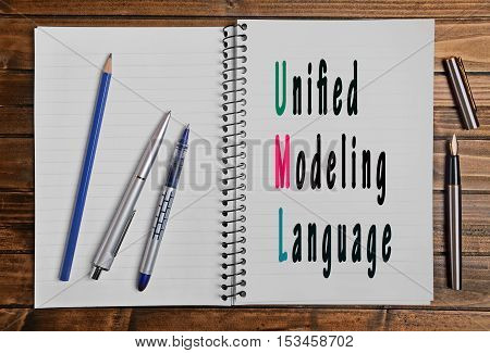 The words Unified Modeling Language on notepad page