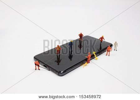 Tiny Worker On Mobile Phone