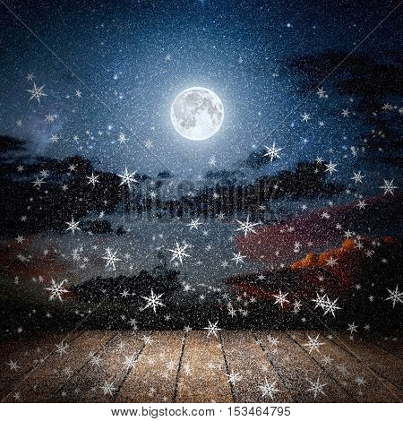 backgrounds night winter sky with stars, snow, moon and clouds. wood floor. Elements of this image furnished by NASA