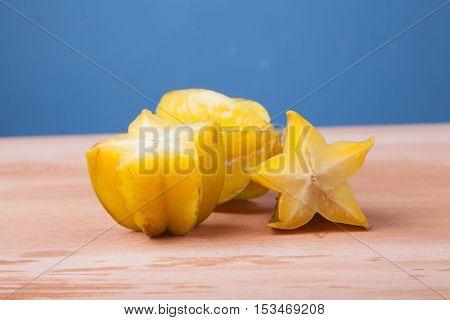 Half Cut Of Starfruit On Wooden Table
