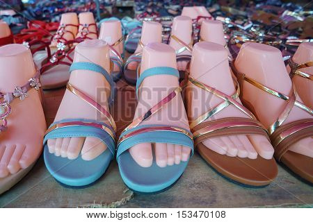 Cheap unbranded woman shoe at open market display in Sabah Malaysian Borneo.
