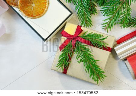 Christmas gift and package items - christmas tree branches, box, paper, - with copy space. Packaging of christmas gift. Overhead view. Christmas mood photo