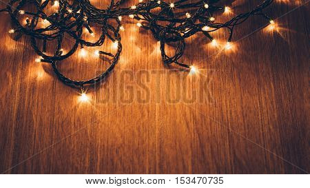 christmas fairy lights on a wooden table,studio shot.