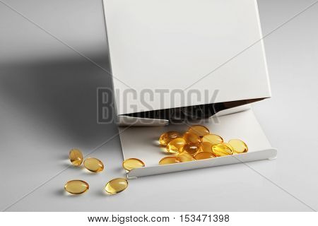 Cod liver oil capsules on white background