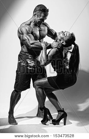 Muscular Man Strangling A Beautiful Woman