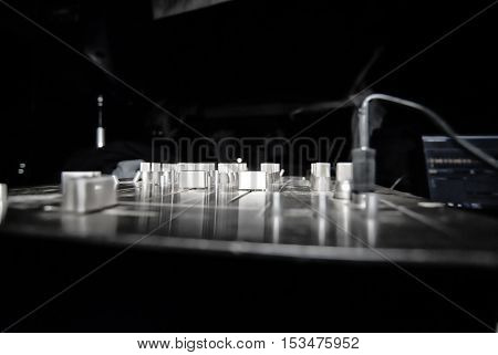 Details of a mixer console in the dark