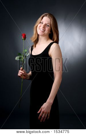 Woman In Black Dress With Rose