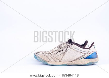 Old worn out futsal sports shoes  on white background  isolated