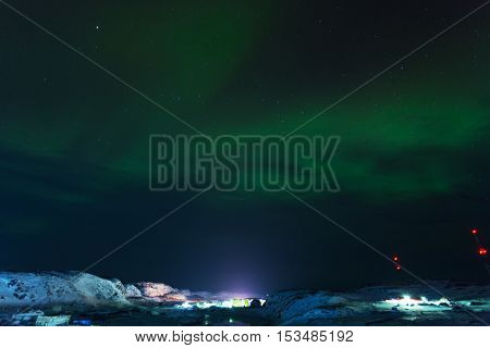 Aurora borealis Green on Teriberka in Murmansk region Russia