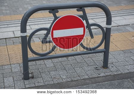 traffic sign against Red and white no entry for bicycles.