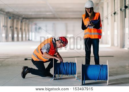 Maintenance Engineers checking cables, toned image, horizontal