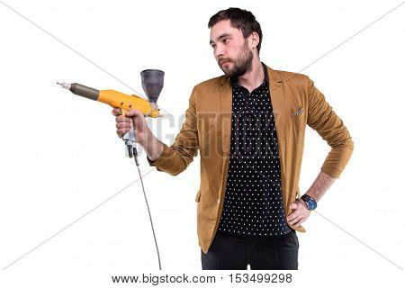 Young man with powder gun on white background