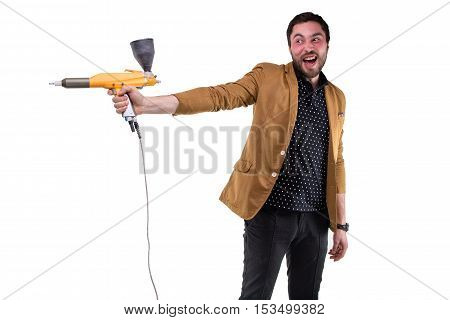 Funny brunette man with powder gun on white background