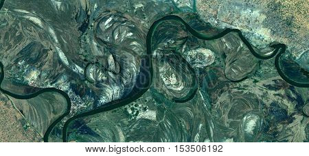 Abstract photography of landscapes of deserts of Africa from the air, river colors, imaginary roads, sinuous lines,
