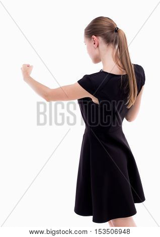 skinny woman funny fights waving his arms and legs. Isolated over white background. Girl in black dress punches.