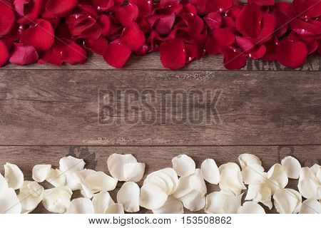 Red And White Rose Petals On The Wooden Background. Rose Petals Border On A Wooden Table. Top View,