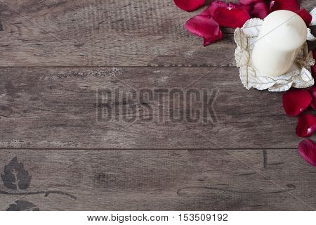 White Aromatic Vanilla Candle And Red Rose Petals. Wooden Background. Aromatherapy Concept. Romantic