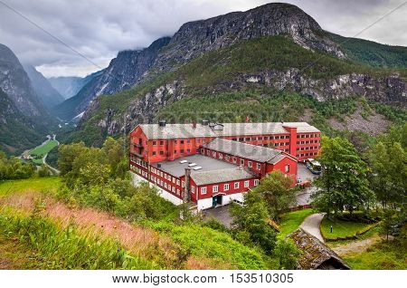 Stalheim Norway - August 01 2010: Tourists come to the Stalheim hotel to admire the beautiful Naeroydalen valley and peaks on August 01 2010 in Stalheim Voss Norway. A coveted location amid the lush green surroundings of the snow-capped peaks of Norway St