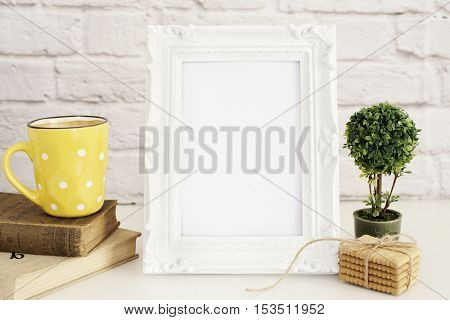 Frame Mockup. White Frame Mock Up. Yellow Cup Of Coffee With White Dots, Cappuccino, Latte, Old Book