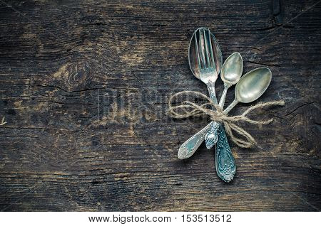 Thanksgiving autumn place setting with cutlery on wooden background. Thanksgiving table setting cutlery on the autumn background. Thanksgiving holidays background concept. Copy space. Top view.