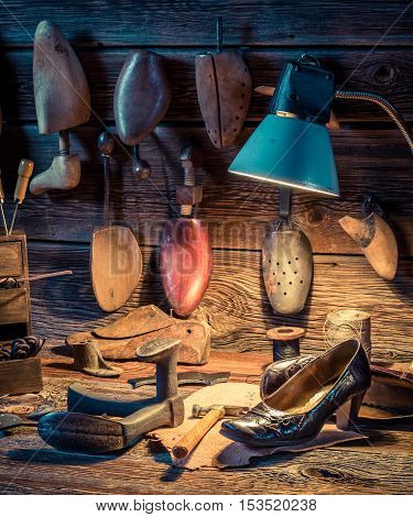 Shoemaker Workshop With Tools, Shoes And Leather