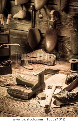 Cobbler Workshop With Tools, Shoes And Leather