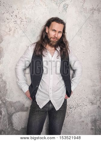 Portrait Of Handsome Man With Beard And Long Hair