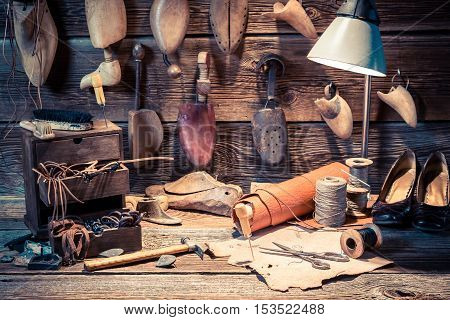 Vintage Cobbler Workplace With Tools, Shoes And Laces