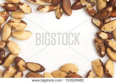 Brazilian Nuts Frame. Castanha do Para isolated on white background