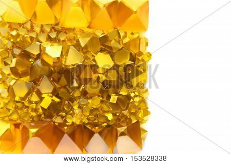 scattered yellow Monocrystal synthetic diamonds on a white background