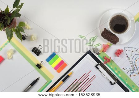 Business blank notepad coffee cup and pen at office desk table top view. Corporate stationery branding mock-up. Copy space for text.