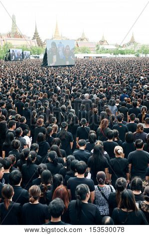 BANGKOK, THAILAND - OCTOBER 22,2016 : Thai people is singing the anthem of His Majesty King Bhumibol at Sanam Luang in front of the Royal Palace to pay respect for the king in Bangkok capital city,Thailand.
