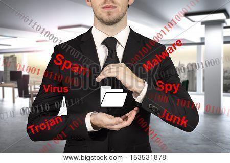 businessman in modern office protecting file folder spam malware