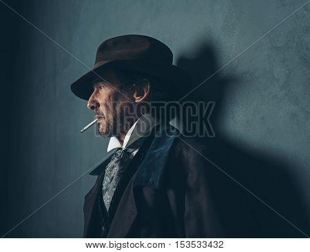 Retro 1900 Western Man With Beard Smoking Cigarette.
